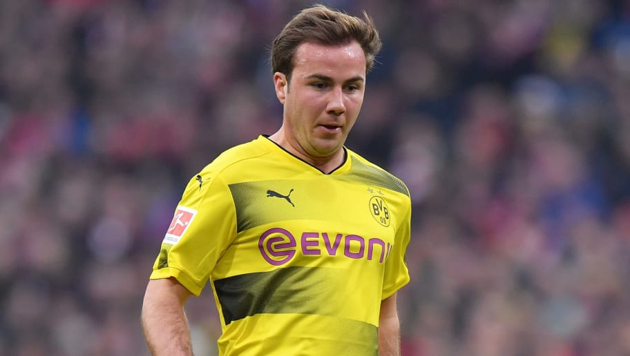 MUNICH, GERMANY - MARCH 31: Mario Goetze of Dortmund plays the ball during the Bundesliga match between FC Bayern Muenchen and Borussia Dortmund at Allianz Arena on March 31, 2018 in Munich, Germany. (Photo by Sebastian Widmann/Bongarts/Getty Images)