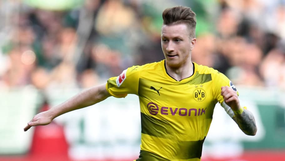 Dortmund's German forward Marco Reus runs with the ball the German first division Bundesliga football match of Werder Bremen versus Borussia Dortmund n April 29, 2018 in Bremen. (Photo by Patrik STOLLARZ / AFP) / RESTRICTIONS: DURING MATCH TIME: DFL RULES TO LIMIT THE ONLINE USAGE TO 15 PICTURES PER MATCH AND FORBID IMAGE SEQUENCES TO SIMULATE VIDEO. == RESTRICTED TO EDITORIAL USE == FOR FURTHER QUERIES PLEASE CONTACT DFL DIRECTLY AT + 49 69 650050        (Photo credit should read PATRIK STOLLARZ/AFP/Getty Images)