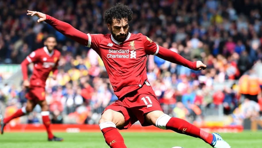 Liverpool's Egyptian midfielder Mohamed Salah controls the ball during the English Premier League football match between Liverpool and Stoke City at Anfield in Liverpool, north west England on April 28, 2018. (Photo by Paul ELLIS / AFP) / RESTRICTED TO EDITORIAL USE. No use with unauthorized audio, video, data, fixture lists, club/league logos or 'live' services. Online in-match use limited to 75 images, no video emulation. No use in betting, games or single club/league/player publications. /         (Photo credit should read PAUL ELLIS/AFP/Getty Images)
