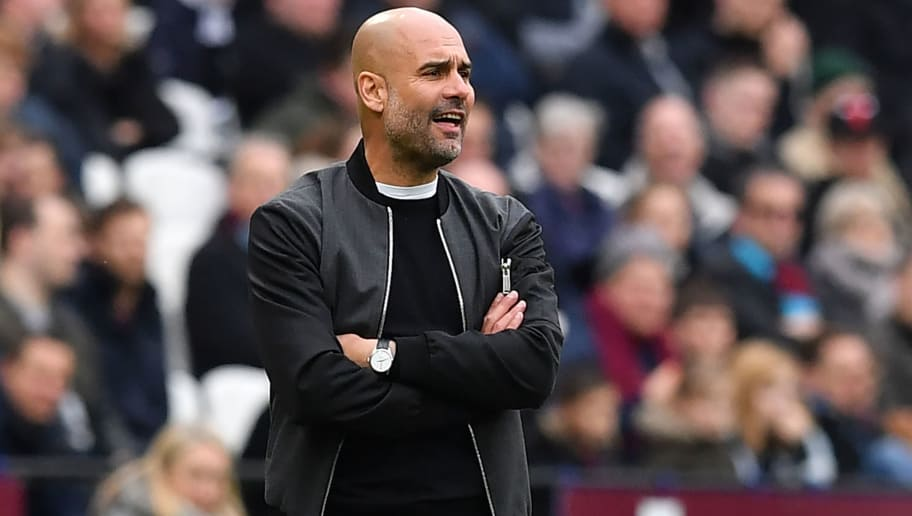 Manchester City's Spanish manager Pep Guardiola watches from the touchline during the English Premier League football match between West Ham United and Manchester City at The London Stadium, in east London on April 29, 2018. (Photo by Ben STANSALL / AFP) / RESTRICTED TO EDITORIAL USE. No use with unauthorized audio, video, data, fixture lists, club/league logos or 'live' services. Online in-match use limited to 75 images, no video emulation. No use in betting, games or single club/league/player publications. /         (Photo credit should read BEN STANSALL/AFP/Getty Images)