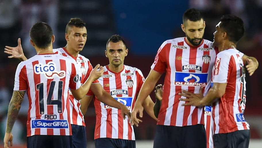 Colombias Atletico Junior players celebrate at the end of their match againts Peru's Alianza Lima during the Copa Libertadores football match at Roberto Melendez stadium in Barranquilla, Colombia on April 26, 2018. (Photo by RAUL ARBOLEDA / AFP)        (Photo credit should read RAUL ARBOLEDA/AFP/Getty Images)