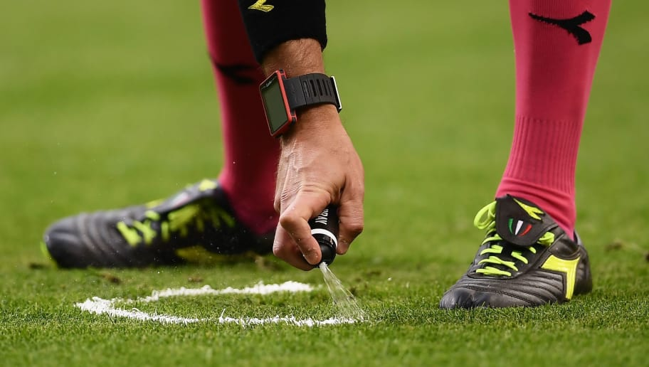 Italian referee Paolo Valeri uses a marking spray during the Italian Serie A football match Inter Milan versus Bologna on February 11, 2018 at the San Siro Stadium in Milan. / AFP PHOTO / MARCO BERTORELLO        (Photo credit should read MARCO BERTORELLO/AFP/Getty Images)