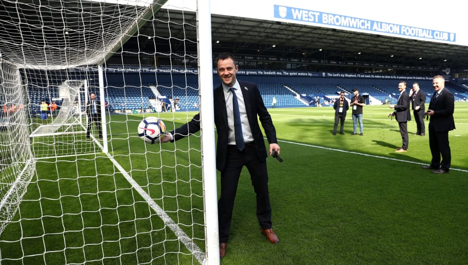 WEST BROMWICH, ENGLAND - APRIL 21:  Match Referee Stuart Attwell tests the goal line technology during the Premier League match between West Bromwich Albion and Liverpool at The Hawthorns on April 21, 2018 in West Bromwich, England.  (Photo by Matthew Lewis/Getty Images)