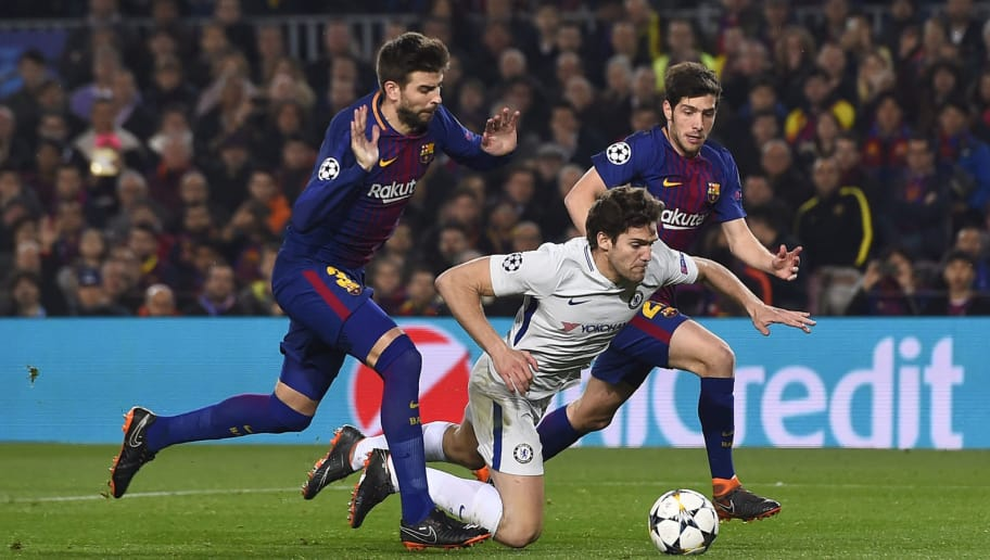 Barcelona's Spanish defender Gerard Pique (L) reacts after fouling Chelsea's Spanish defender Marcos Alonso next to Barcelona's Spanish midfielder Sergi Roberto (back) during the UEFA Champions League round of sixteen second leg football match between FC Barcelona and Chelsea FC at the Camp Nou stadium in Barcelona on March 14, 2018. / AFP PHOTO / Josep LAGO        (Photo credit should read JOSEP LAGO/AFP/Getty Images)