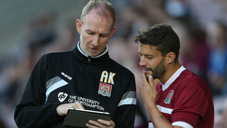 NORTHAMPTON, ENGLAND - JULY 21:  Northampton Town assistant manager Alan Knill uses an ipad to give instructions to Marc Richards during the Pre-Season Friendly match between Northampton Town and Birmingham City at Sixfields Stadium on July 21, 2015 in Northampton, England.  (Photo by Pete Norton/Getty Images)