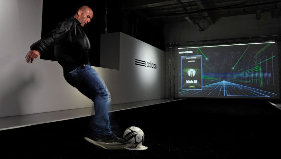 LONDON - MAY 24:  In this handout image provided by adidas,  Zinedine Zidane redefining the future of football with the Smart Ball at the adidas lab, London on May 24 in London, England. The system measures essential physiological data of a team in real time, and sends it straight to a coaches tablet on the side line allowing them to be one step ahead of the game.  (Photo by Gary Prior/adidas via Getty Images)