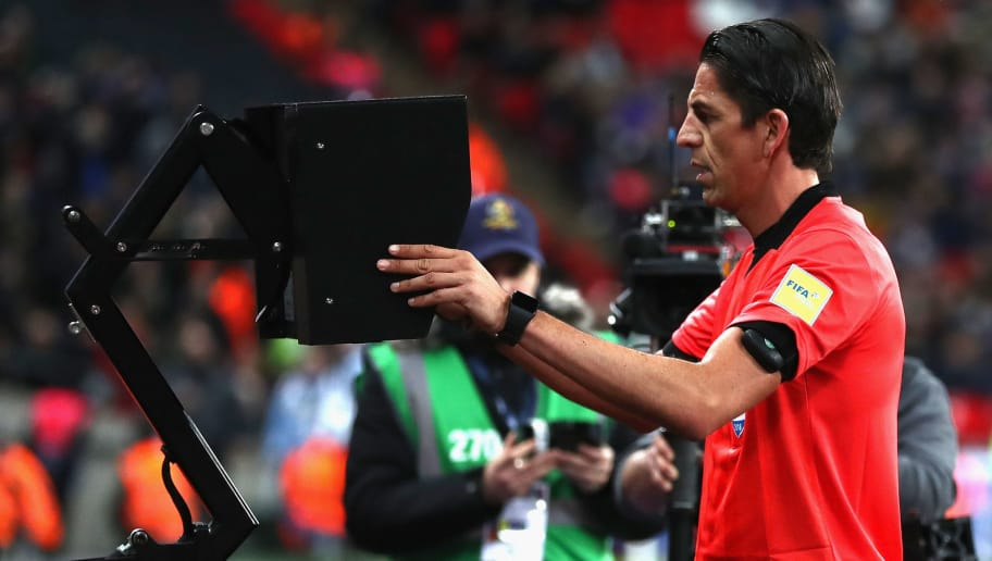 LONDON, ENGLAND - MARCH 27:  Referee Deniz Aytekin checks the VAR during the International friendly between England and Italy at Wembley Stadium on March 27, 2018 in London, England.  (Photo by Catherine Ivill/Getty Images)