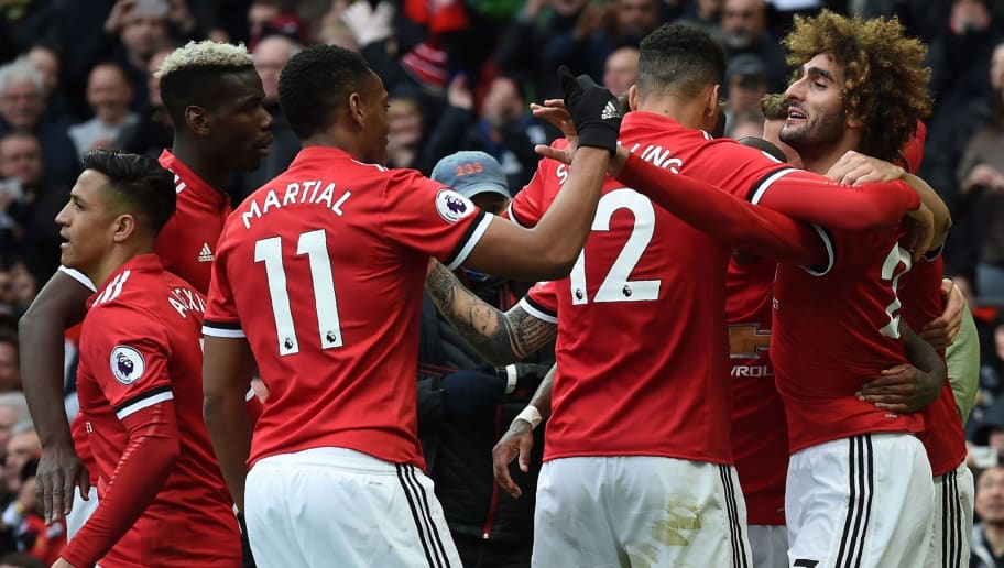 Manchester United's Belgian midfielder Marouane Fellaini (R) celebrates with teammates after scoring their late second goal during the English Premier League football match between Manchester United and Arsenal at Old Trafford in Manchester, north west England, on April 29, 2018. (Photo by Paul ELLIS / AFP) / RESTRICTED TO EDITORIAL USE. No use with unauthorized audio, video, data, fixture lists, club/league logos or 'live' services. Online in-match use limited to 75 images, no video emulation. No use in betting, games or single club/league/player publications. /         (Photo credit should read PAUL ELLIS/AFP/Getty Images)