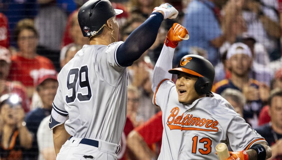 WASHINGTON, DC - JULY 17: Aaron Judge #99 of the New York Yankees reacts with Manny Machado #13 of the Baltimore Orioles after hitting a solo home run during the second inning of the 89th MLB All-Star Game at Nationals Park Tuesday, July 17, 2018 in Washington, DC. (Photo by Billie Weiss/Boston Red Sox/Getty Images)
