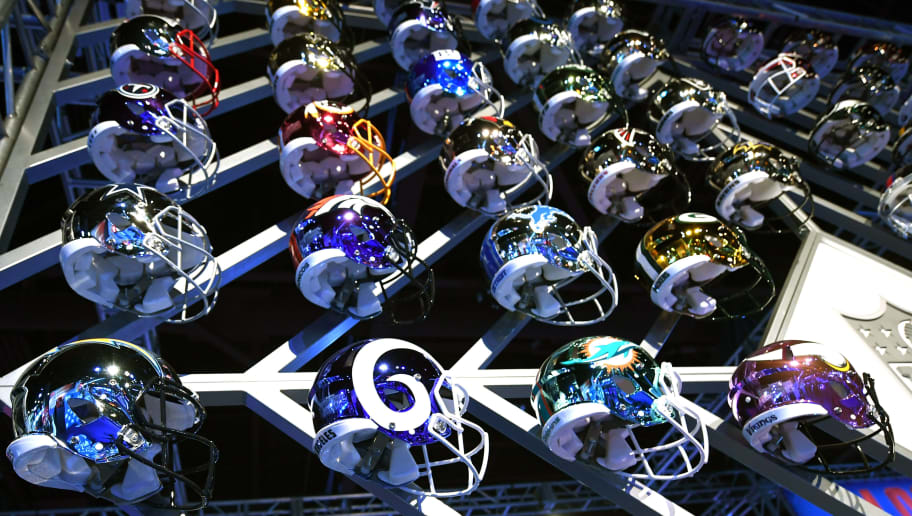 Team helmets are on display at the Super Bowl Experience at the World Congress Center in Atlanta, Georgia February 1, 2019. - The New England Patriots will meet the Los Angeles Ram at Super Bowl LIII on February 3. (Photo by TIMOTHY A. CLARY / AFP)        (Photo credit should read TIMOTHY A. CLARY/AFP/Getty Images)