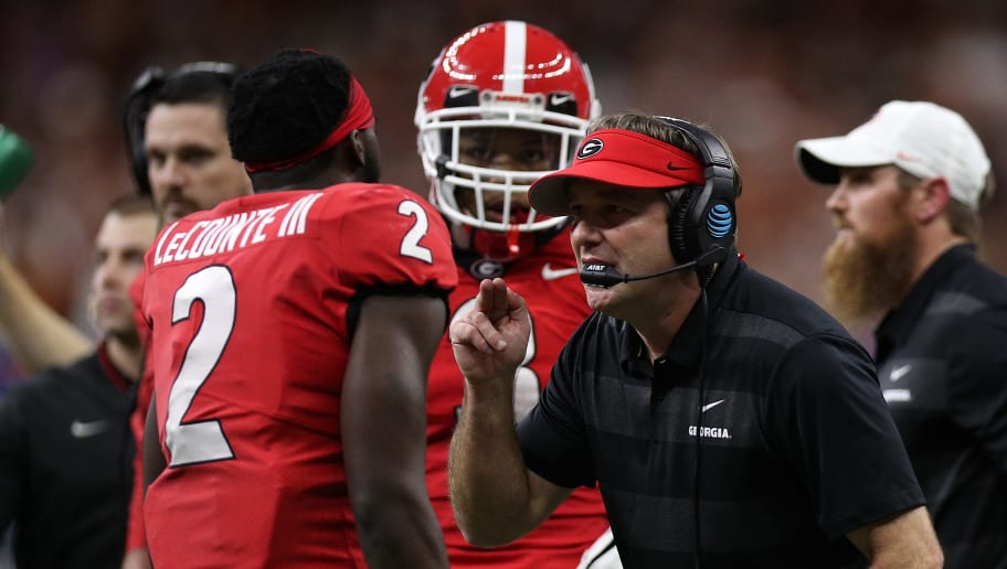 NEW ORLEANS, LOUISIANA - JANUARY 01:  Kirby Smart, head coach of the Georgia Bulldogs talks with Richard LeCounte #2 of the Georgia Bulldogs during the Allstate Sugar Bowl at Mercedes-Benz Superdome on January 01, 2019 in New Orleans, Louisiana. (Photo by Chris Graythen/Getty Images)