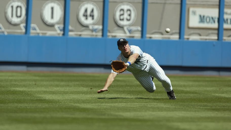 BRONX, NY - AUGUST 21:  Leftfielder Shane Spencer #47 of the New York Yankees looks to make a diving catch of the ball off of the bat of leftfielder Garret Anderson #16 of the Anaheim Angels during the game at Yankee Stadium in the Bronx, New York on August 21, 2002.  The Angels defeated the Yankees 5-1.  (Photo by Al Bello/Getty Images)