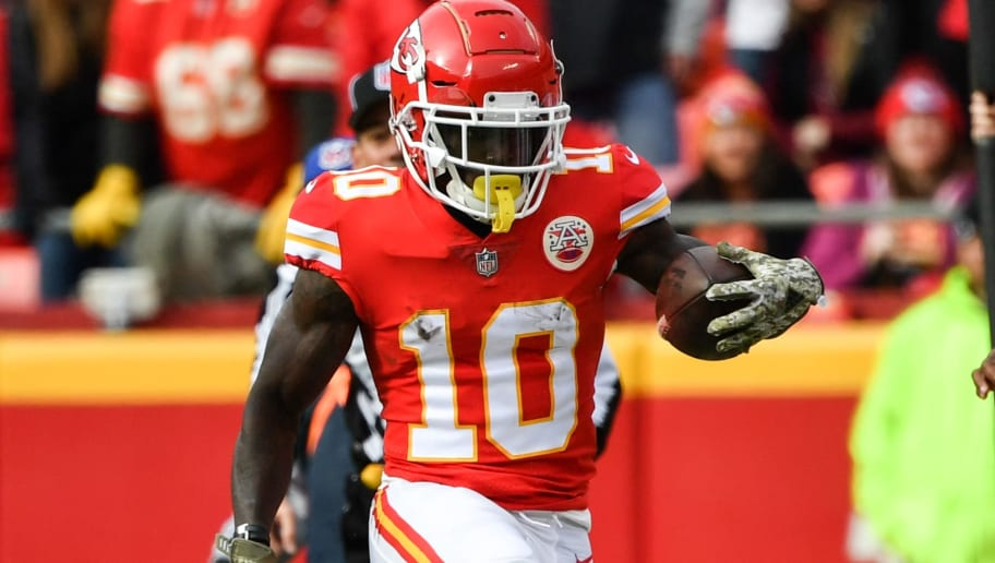 KANSAS CITY, MO - NOVEMBER 11: Tyreek Hill #10 of the Kansas City Chiefs high steps down the sidelines during the second half of the game against the Arizona Cardinals at Arrowhead Stadium on November 11, 2018 in Kansas City, Missouri. (Photo by Peter Aiken/Getty Images)