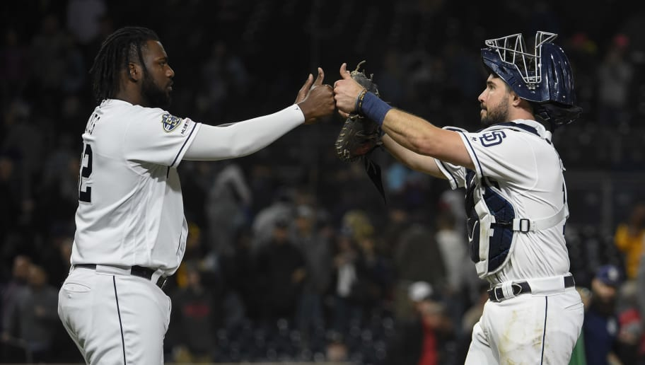 SAN DIEGO, CA - MAY 21: Franmil Reyes #32 of the San Diego Padres and Austin Hedges #18 celebrate after beating the Arizona Diamondbacks 3-2 in a baseball game at Petco Park May 21, 2019 in San Diego, California.  (Photo by Denis Poroy/Getty Images)