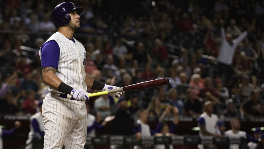 PHOENIX, ARIZONA - MAY 09: David Peralta #6 of the Arizona Diamondbacks hits a solo home run in the ninth inning of the MLB game against the Atlanta Braves at Chase Field on May 09, 2019 in Phoenix, Arizona. (Photo by Jennifer Stewart/Getty Images)