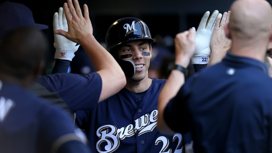 MILWAUKEE, WISCONSIN - JULY 17:  Christian Yelich #22 of the Milwaukee Brewers celebrates with teammates after hitting a home run in the sixth inning against the Atlanta Braves at Miller Park on July 17, 2019 in Milwaukee, Wisconsin. (Photo by Dylan Buell/Getty Images)