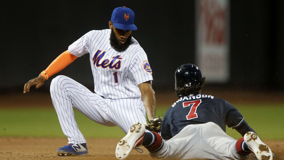 NEW YORK, NEW YORK - JUNE 30:   Amed Rosario #1 of the New York Mets tags out Dansby Swanson #7 of the Atlanta Braves as he tries to steal second base ending the fifth inning at Citi Field on June 30, 2019 in New York City. (Photo by Jim McIsaac/Getty Images)