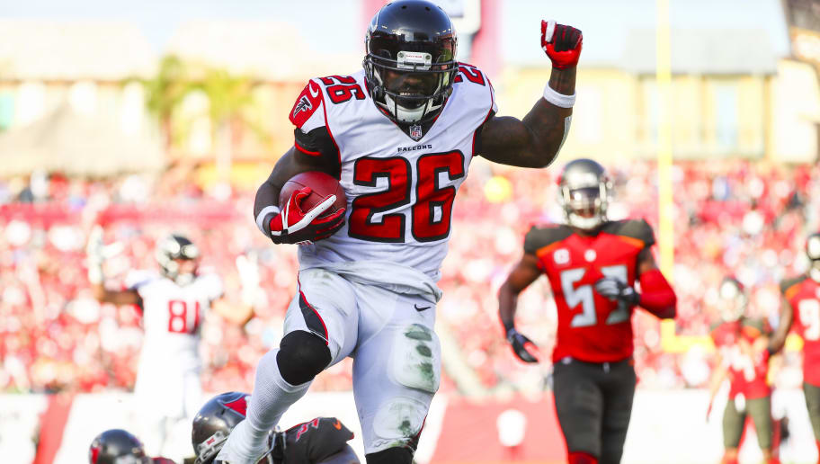 TAMPA, FL - DECEMBER 30: Running back Tevin Coleman #26 of the Atlanta Falcons high steps into the end zone to score in the third quarter of the game at Raymond James Stadium on December 30, 2018 in Tampa, Florida. (Photo by Will Vragovic/Getty Images)