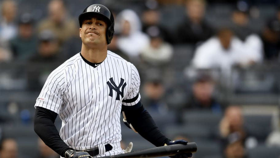 NEW YORK, NEW YORK - MARCH 28: Giancarlo Stanton #27 of the New York Yankees reacts after striking out during the eighth inning of the game against the Baltimore Orioles during Opening Day at Yankee Stadium on March 28, 2019 in the Bronx borough of New York City. (Photo by Sarah Stier/Getty Images)
