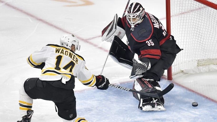RALEIGH, NORTH CAROLINA - MAY 14: Chris Wagner #14 of the Boston Bruins scores a goal on Curtis McElhinney #35 of the Carolina Hurricanes during the second period in Game Three of the Eastern Conference Finals during the 2019 NHL Stanley Cup Playoffs at PNC Arena on May 14, 2019 in Raleigh, North Carolina. (Photo by Grant Halverson/Getty Images)