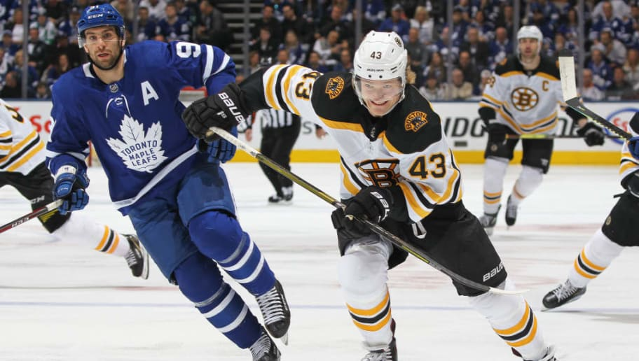TORONTO, ON - APRIL 21:  Danton Heinen #43 of the Boston Bruins skates against John Tavares #91 of the Toronto Maple Leafs in Game Six of the Eastern Conference First Round during the 2019 NHL Stanley Cup Playoffs at Scotiabank Arena on April 21, 2019 in Toronto, Ontario, Canada. The Bruins defeated the Maple Leafs 4-2. (Photo by Claus Andersen/Getty Images)
