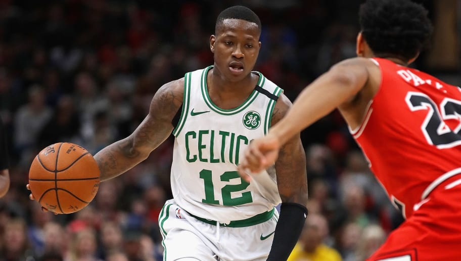 CHICAGO, IL - MARCH 05:  Terry Rozier #12 of the Boston Celtics moves against Cameron Payne #22 of the Chicago Bulls at the United Center on March 5, 2018 in Chicago, Illinois. The Celtics defeated the Bulls 105-89. NOTE TO USER: User expressly acknowledges and agrees that, by downloading and or using this photograph, User is consenting to the terms and conditions of the Getty Images License Agreement. (Photo by Jonathan Daniel/Getty Images)