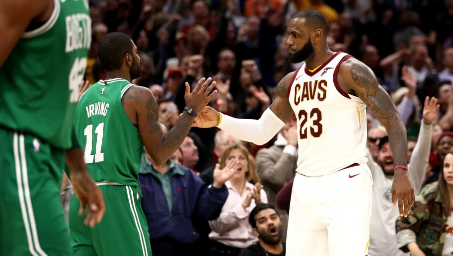 CLEVELAND, OH - OCTOBER 17:  LeBron James #23 of the Cleveland Cavaliers and Kyrie Irving #11 of the Boston Celtics shake hands after a Cavaliers 102-99 victory at Quicken Loans Arena on October 17, 2017 in Cleveland, Ohio. NOTE TO USER: User expressly acknowledges and agrees that, by downloading and or using this photograph, User is consenting to the terms and conditions of the Getty Images License Agreement.  (Photo by Gregory Shamus/Getty Images)