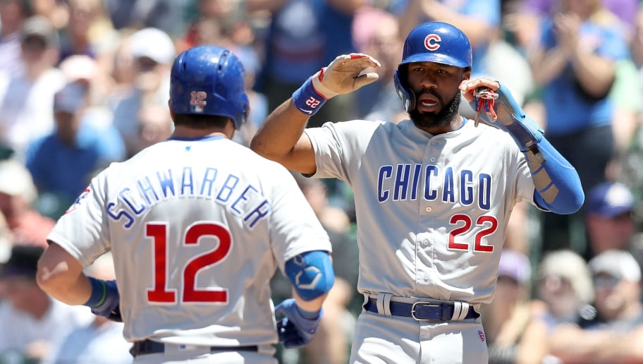 DENVER, COLORADO - JUNE 12: Kyle Schwarber #12 of the Chicago Cubs is congratulated at the plate by Jason Heyward #22 after hitting a three-run home run in the second inning against the Colorado Rockies at Coors Field on June 12, 2019 in Denver, Colorado. (Photo by Matthew Stockman/Getty Images)