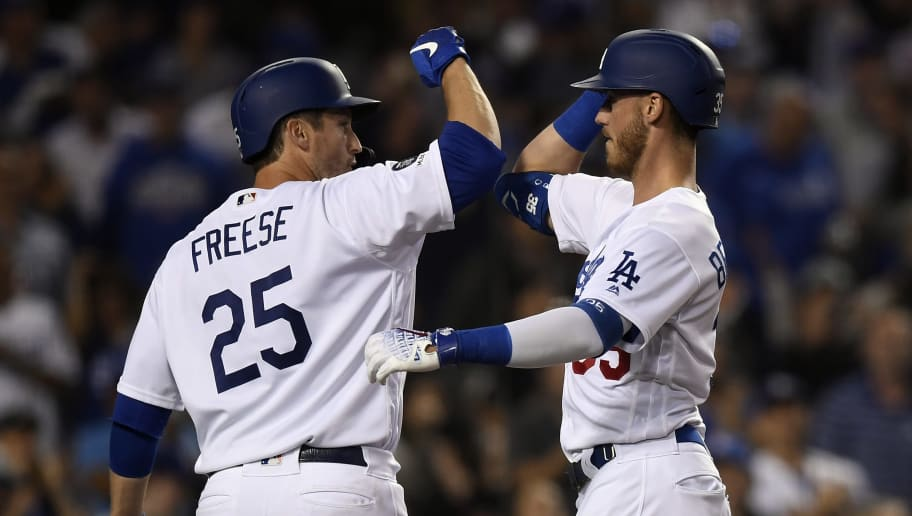 LOS ANGELES, CA - JUNE 13: Cody Bellinger #35 of the Los Angeles Dodgers celebrate his two run home run with David Freese #25 against pitcher Jon Lester #34 of the Chicago Cubs during the fourth inning to at Dodger Stadium on June 13, 2019 in Los Angeles, California. (Photo by Kevork Djansezian/Getty Images)