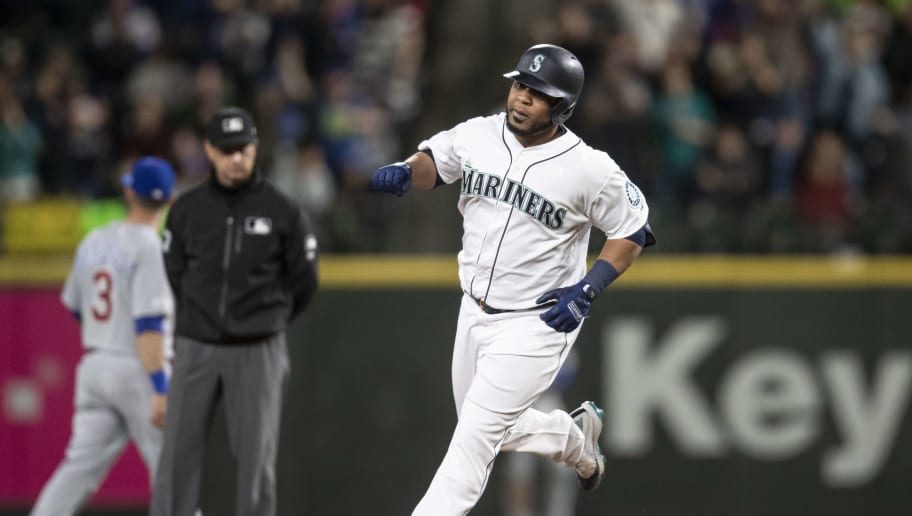 SEATTLE, WA - APRIL 30: Edwin Encarnacion #10 of the Seattle Mariners rounds the bases after hitting a solo home run off of relief pitcher Brandon Kintzler #20 of the Chicago Cubs during the seventh inning of a game at T-Mobile Park on April 30, 2019 in Seattle, Washington. The Cubs won 6-5. (Photo by Stephen Brashear/Getty Images)