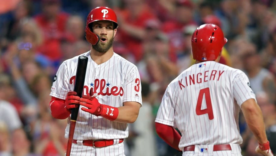 PHILADELPHIA, PA - JUNE 07: Bryce Harper #3 of the Philadelphia Phillies reacts to Scott Kingery #4 scoring on an error in the fifth inning against the Cincinnati Reds at Citizens Bank Park on June 7, 2019 in Philadelphia, Pennsylvania. The Phillies won 4-2. (Photo by Drew Hallowell/Getty Images)