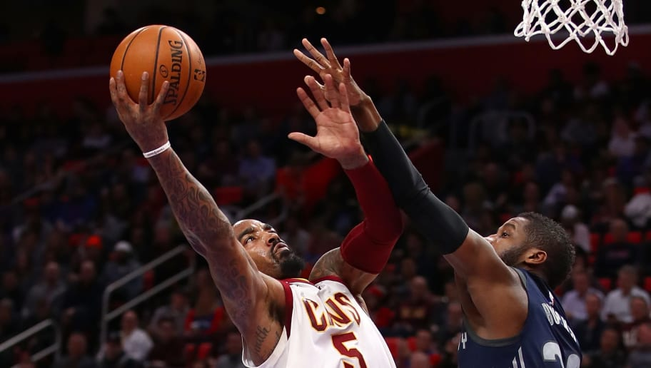 DETROIT, MI - JANUARY 30: JR Smith #5 of the Cleveland Cavaliers tries to get a shot off past Dwight Buycks #20 of the Detroit Pistons during the first half at Little Caesars Arena on January 30, 2018 in Detroit, Michigan. NOTE TO USER: User expressly acknowledges and agrees that, by downloading and or using this photograph, User is consenting to the terms and conditions of the Getty Images License Agreement. (Photo by Gregory Shamus/Getty Images)
