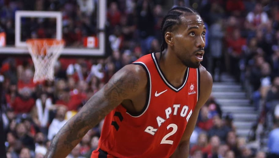 TORONTO, ON - OCTOBER 17:  Kawhi Leonard #2 of the Toronto Raptors dribbles the ball during the second half of the NBA season opener against the Cleveland Cavaliers at Scotiabank Arena on October 17, 2018 in Toronto, Canada.  NOTE TO USER: User expressly acknowledges and agrees that, by downloading and or using this photograph, User is consenting to the terms and conditions of the Getty Images License Agreement.  (Photo by Vaughn Ridley/Getty Images)