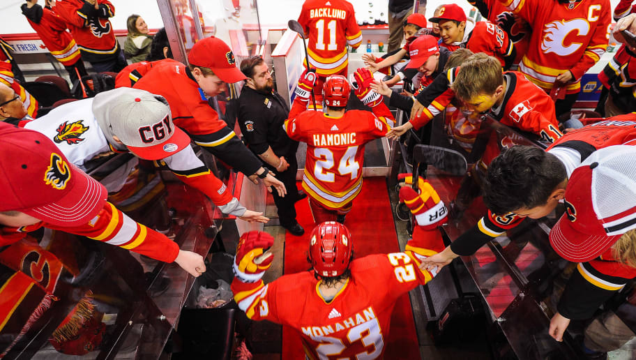 CALGARY, AB - APRIL 11: Mikael Backlund #11, Travis Hamonic #24, and Sean Monahan #23 of the Calgary Flames walk out for warm-ups prior to Game One of the Western Conference First Round against the Colorado Avalanche during the 2019 NHL Stanley Cup Playoffs at Scotiabank Saddledome on March 15, 2019 in Calgary, Alberta, Canada. (Photo by Derek Leung/Getty Images)