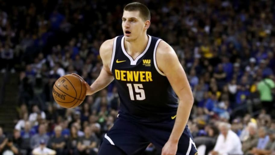 OAKLAND, CALIFORNIA - APRIL 02:  Nikola Jokic #15 of the Denver Nuggets in action against the Golden State Warriors at ORACLE Arena on April 02, 2019 in Oakland, California.  NOTE TO USER: User expressly acknowledges and agrees that, by downloading and or using this photograph, User is consenting to the terms and conditions of the Getty Images License Agreement. (Photo by Ezra Shaw/Getty Images)