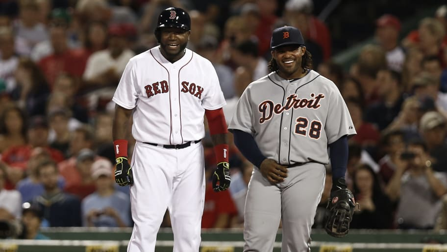 BOSTON, MA - SEPTEMBER 3:  Prince Fielder #28 of the Detroit Tigers and David Ortiz #34 of the Boston Red Sox share a laugh at first base after Ortiz walked during the sixth inning at Fenway Park on September 3, 2013 in Boston, Massachusetts.  (Photo by Winslow Townson/Getty Images)