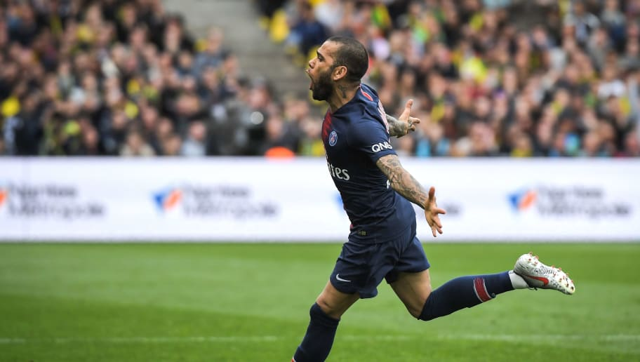 Paris Saint-Germain's Brazilian defender Dani Alves celebrates after scoring during the French L1 football match between Nantes (FC Nantes) and Paris Saint-Germain (PSG) at the La Beaujoire stadium in Nantes, western France, on April 17, 2019. (Photo by LOIC VENANCE / AFP)        (Photo credit should read LOIC VENANCE/AFP/Getty Images)