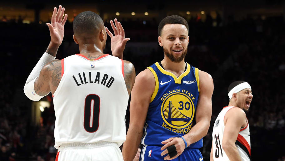 PORTLAND, OREGON - MAY 18: (L-R) Damian Lillard #0 of the Portland Trail Blazers, Stephen Curry #30 of the Golden State Warriors and Seth Curry #31 of the Portland Trail Blazers react during the first half in game three of the NBA Western Conference Finals at Moda Center on May 18, 2019 in Portland, Oregon. NOTE TO USER: User expressly acknowledges and agrees that, by downloading and or using this photograph, User is consenting to the terms and conditions of the Getty Images License Agreement. (Photo by Steve Dykes/Getty Images)