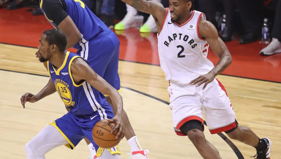 TORONTO,ONTARIO - JUNE 10:  Kevin Durant #35 of the Golden State Warriors eludes Kawhi Leonard #2 of the Toronto Raptors during Game Five of the 2019 NBA Finals at Scotiabank Arena on June 10, 2019 in Toronto, Canada. NOTE TO USER: User expressly acknowledges and agrees that, by downloading and or using this photograph, User is consenting to the terms and conditions of the Getty Images License Agreement. (Photo by Claus Andersen/Getty Images)