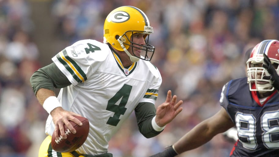 Brett Favre #4 of the Green Bay Packers against Ryan Neufeld #88 of the Buffalo Bills during a game between the Green Bay Packers and Buffalo Bills at Ralph Wilson Stadium in Orchard Park, New York on November 5, 2006. Buffalo won 24-10. (Photo by Mark Konezny/NFLPhotoLibrary)