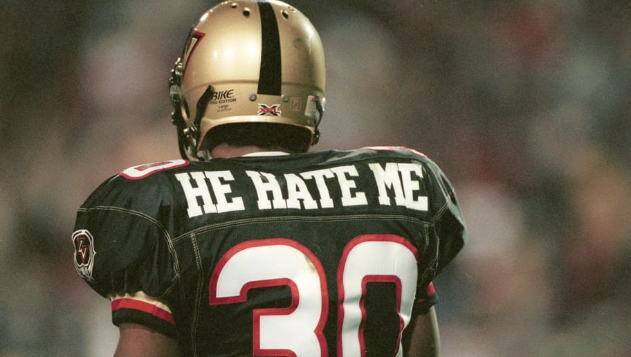 """3 Feb 2001:  Rod """"He Hate Me"""" Smart #30 of the Las Vegas Outlaws in action against the New York/New Jersey Hitmen at Sam Boyd Stadium in Las Vegas, Nevada. The Outlaws won 19-0. Mandatory Credit: Todd Warshaw/ALLSPORT"""