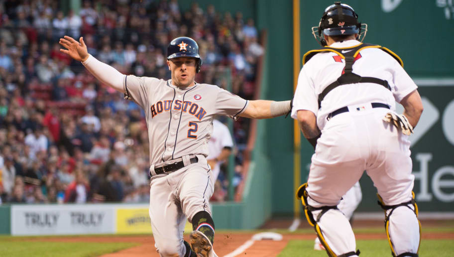 BOSTON, MA - MAY 18: Alex Bregman #2 of the Houston Astros safely slides into home plate in the first inning against the Boston Red Sox at Fenway Park on May 18, 2019 in Boston, Massachusetts. (Photo by Kathryn Riley/Getty Images)
