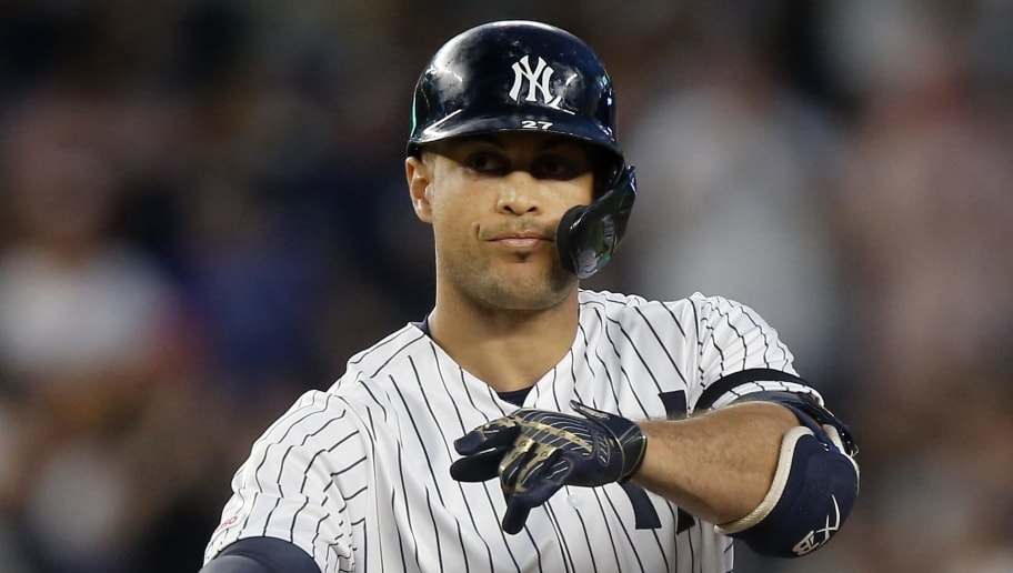 NEW YORK, NEW YORK - JUNE 20:   Giancarlo Stanton #27 of the New York Yankees reacts at second base after his fourth inning double against the Houston Astros at Yankee Stadium on June 20, 2019 in the Bronx borough of New York City. (Photo by Jim McIsaac/Getty Images)