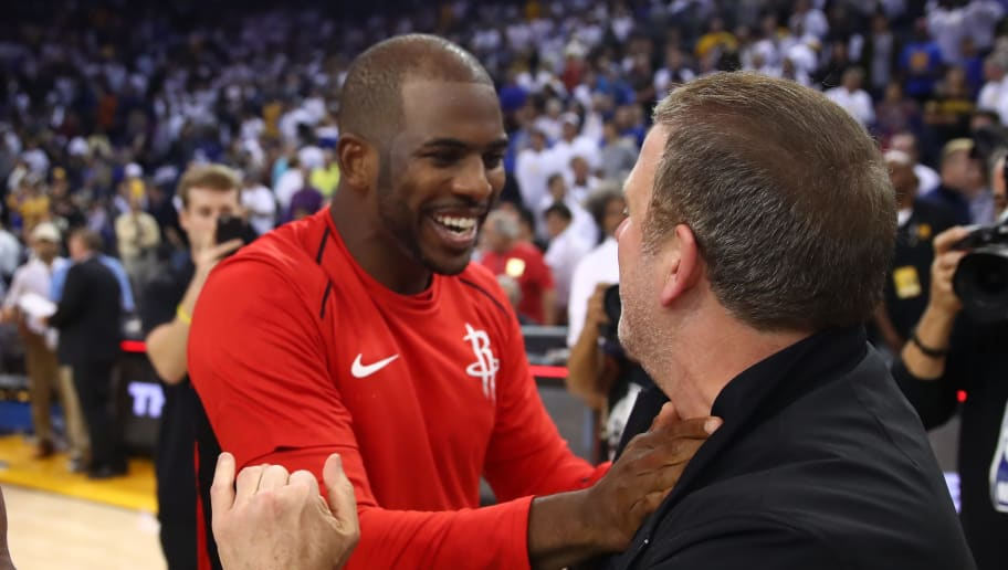 OAKLAND, CA - OCTOBER 17:  PJ Tucker #4, Chris Paul #3 and team owner Tilman Fertitta of the Houston Rockets celebrate after defeating the Golden State Warriors 122-121 in their NBA game at ORACLE Arena on October 17, 2017 in Oakland, California. NOTE TO USER: User expressly acknowledges and agrees that, by downloading and or using this photograph, User is consenting to the terms and conditions of the Getty Images License Agreement.  (Photo by Ezra Shaw/Getty Images)