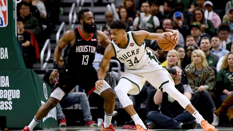MILWAUKEE, WISCONSIN - MARCH 26:  Giannis Antetokounmpo #34 of the Milwaukee Bucks is defended by James Harden #13 of the Houston Rockets during the second half of a game at Fiserv Forum on March 26, 2019 in Milwaukee, Wisconsin. NOTE TO USER: User expressly acknowledges and agrees that, by downloading and or using this photograph, User is consenting to the terms and conditions of the Getty Images License Agreement. (Photo by Stacy Revere/Getty Images)