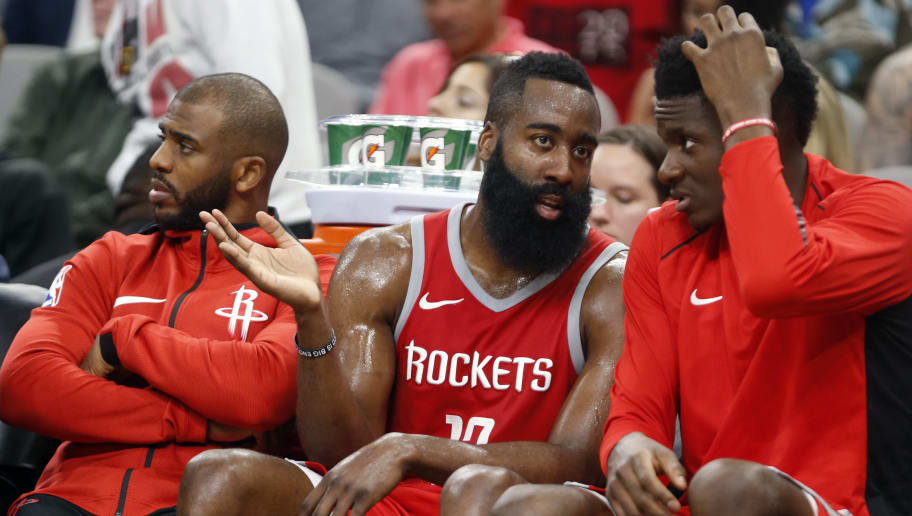 SAN ANTONIO,TX - APRIL 1 :  James Harden #13 of the Houston Rockets talks with teammate Clint Capela #15 of the Houston Rockets while Chris Paul #3 of the Houston Rockets,L watches the game at AT&T Center on April 1 , 2018  in San Antonio, Texas.  NOTE TO USER: User expressly acknowledges and agrees that , by downloading and or using this photograph, User is consenting to the terms and conditions of the Getty Images License Agreement. (Photo by Ronald Cortes/Getty Images)