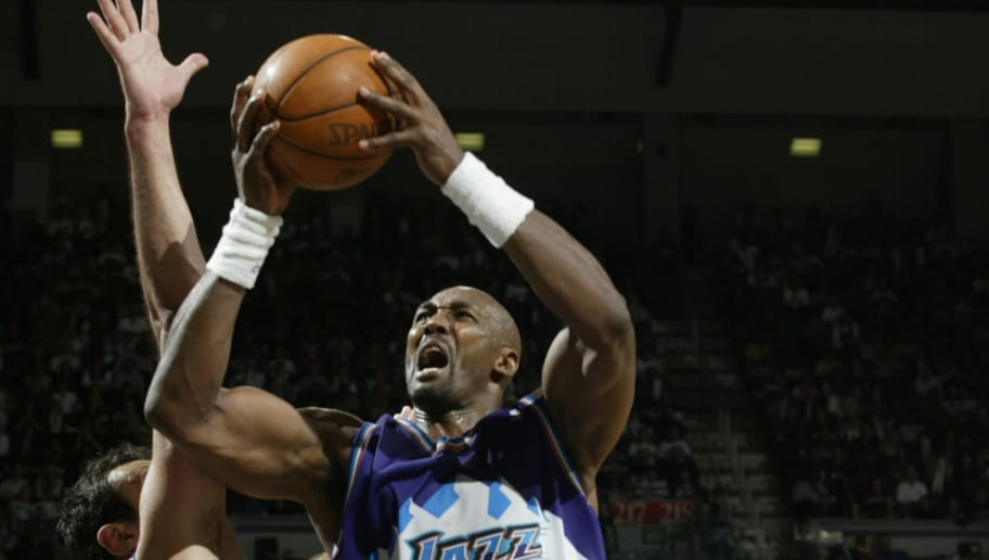 SACRAMENTO, CA - APRIL 30:  Karl Malone #32 of the Utah Jazz shoots past Vlade Divac #21 of the Sacramento Kings in Game five of the Western Conference Quarterfinals during the 2003 NBA Playoffs at Arco Arena on April 30, 2003 in Sacramento, California.  The Kings won 111-91.  NOTE TO USER: User expressly acknowledges and agrees that, by downloading and/or using this Photograph, User is consenting to the terms and conditions of the Getty Images License Agreement. (Photo by: Jed Jacobsohn/Getty Images)