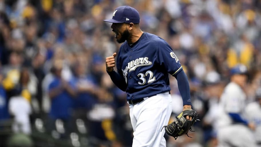 MILWAUKEE, WI - OCTOBER 12:  Jeremy Jeffress #32 of the Milwaukee Brewers reacts against the Los Angeles Dodgers during the eighth inning in Game One of the National League Championship Series at Miller Park on October 12, 2018 in Milwaukee, Wisconsin.  (Photo by Stacy Revere/Getty Images)
