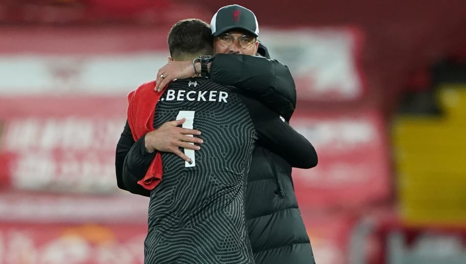 Klopp hugs Alisson after a vital win for Liverpool