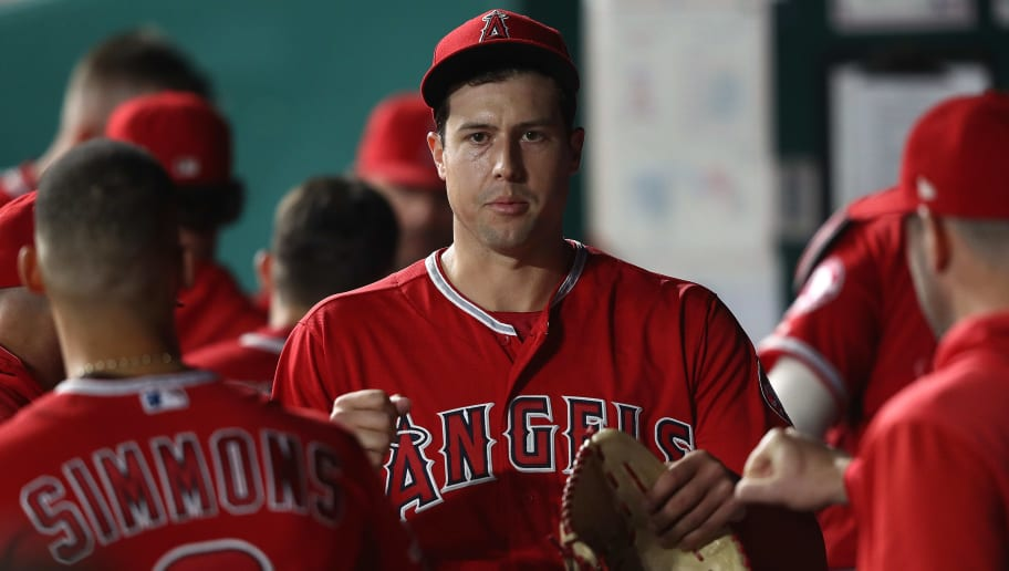 KANSAS CITY, MISSOURI - APRIL 26:  Starting pitcher Tyler Skaggs #45 of the Los Angeles Angels is congratulated by teammates in the dugout after striking out Ryan O'Hearn #66 of the Kansas City Royals for the third out with the bases loaded during the 4th inning of the game at Kauffman Stadium on April 26, 2019 in Kansas City, Missouri. (Photo by Jamie Squire/Getty Images)
